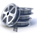 Stack of  movie films spool with film