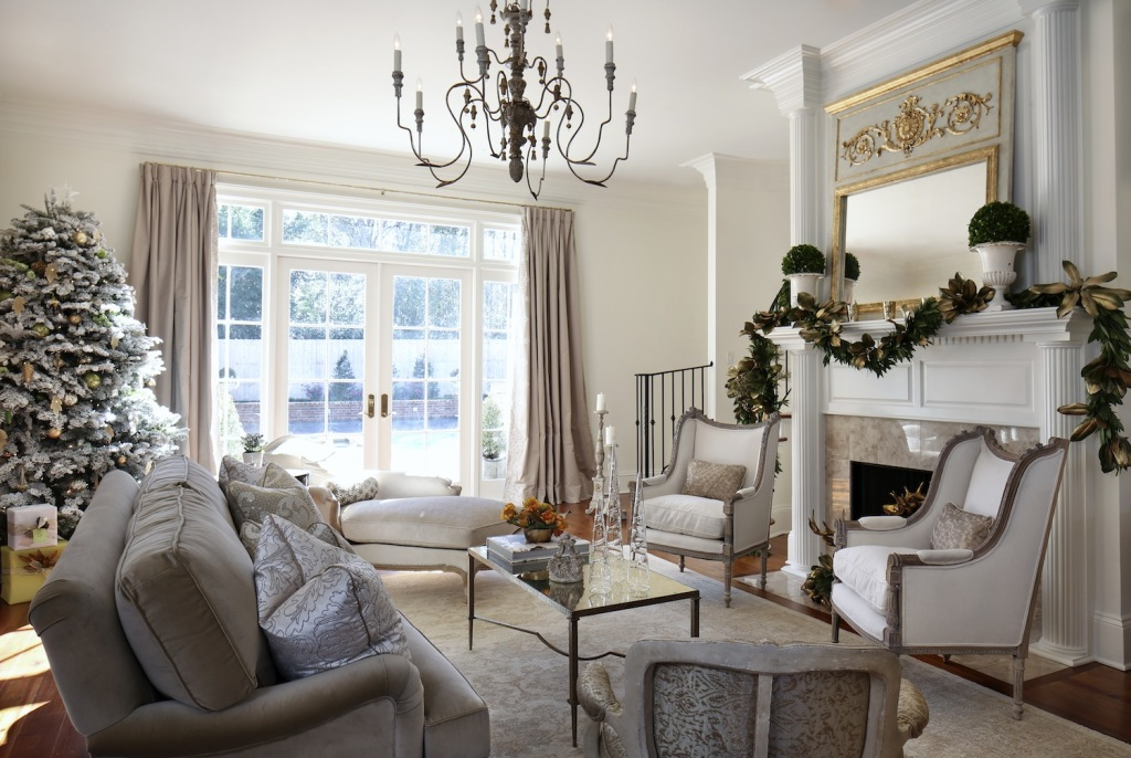 The look of the formal living room, Alayna's favorite room in the house, was inspired by the graceful homes of the Garden District in her hometown of New Orleans. The soothing palette of whites and creams is balanced by accents like a Trumeau mirror by Julie Neill and an Italian chandelier.