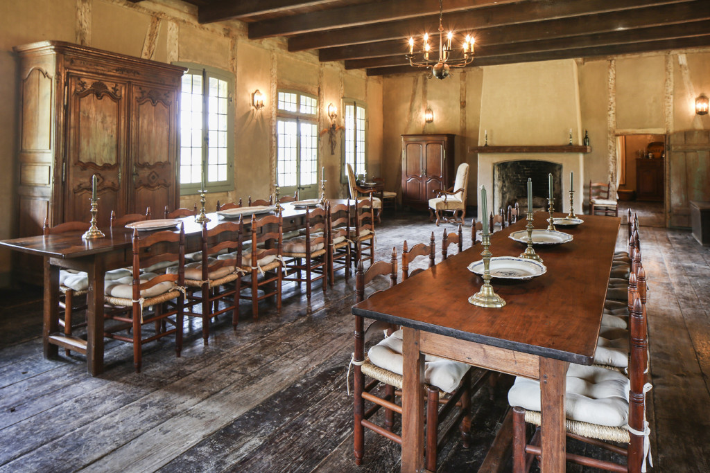The salle, or dining room, in the LaCour House holds long tables that were once in the Ursuline Convent in New Orleans. The Holdens now use this space to host holiday dinners with extended family members.