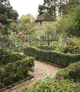 Maison Chenal's front garden is laid out in the French parterre style, with a view of the pigeonnier beyond.