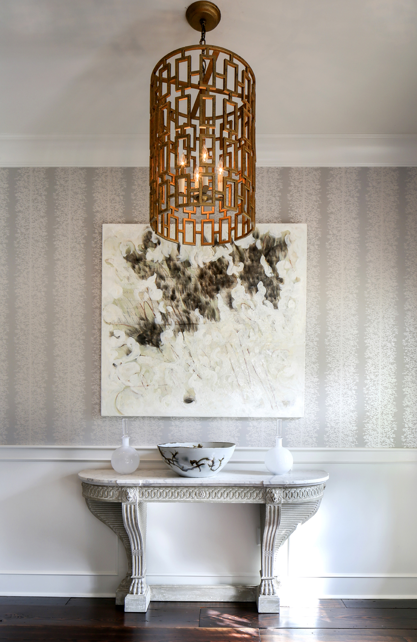An abstract painting by New Orleans artist Karoline Schleh is set against  subtly shimmering Anna French The foyer has what designer Anne McCanless ...