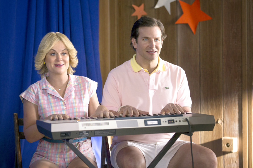 Amy Poehler and Bradley Cooper sport perfect 1980s pastels in a scene from Wet Hot American Summer: First Day of Camp, for which Schilling served as costume designer.